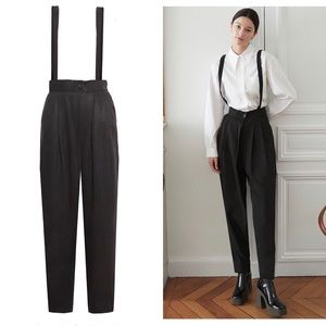 Black high waisted trousers with suspenders